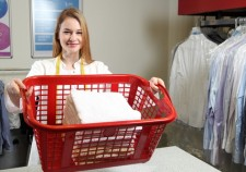 37241035 - an employee of a dry cleaning with a  laundry basket