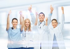 21034335 - healthcare and medical - professional young team or group of doctors showing thumbs up