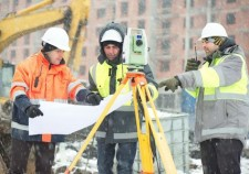35942440 - civil engineers at construction site are inspecting ongoing works according to design drawings in difficult winter conditions