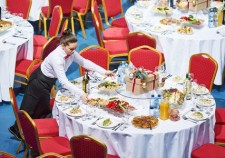 68393632 - restaurant waitress serving table with food