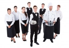 Large group of waiters and waitresses. Isolated on white