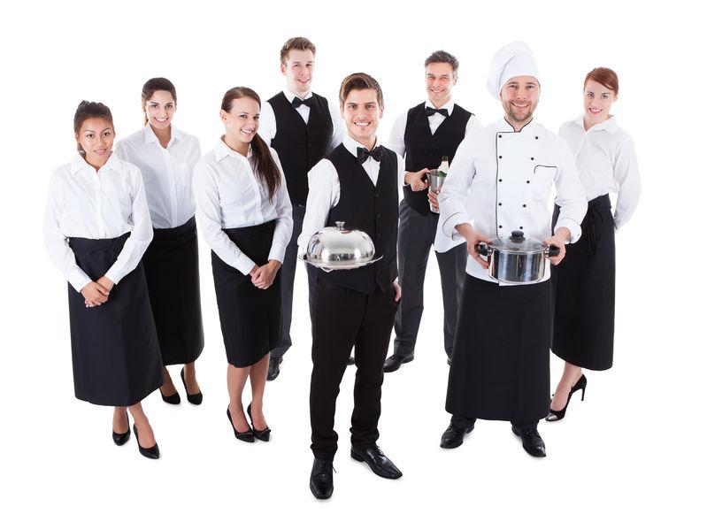 Large group of waiters and waitresses. Isolated on white