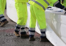 civil protection men with high visibility clothing during an exercise to prevent flooding in the city