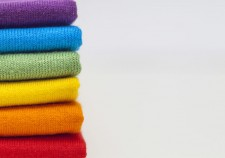 A stack of colourful shirts with space for extra text or logo
