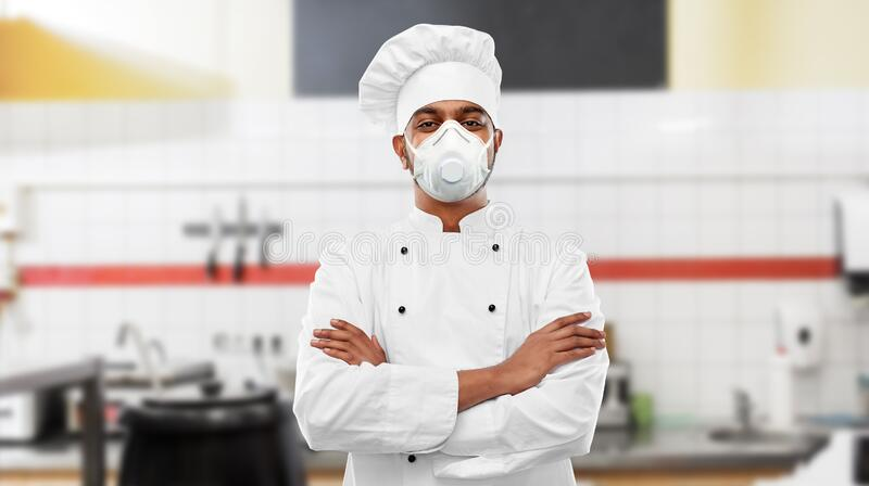 health-protection-safety-pandemic-concept-indian-male-chef-cook-wearing-face-protective-mask-respirator-crossed-arms-178959484