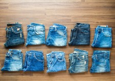Collection jeans stacked on a wooden background, View from above
